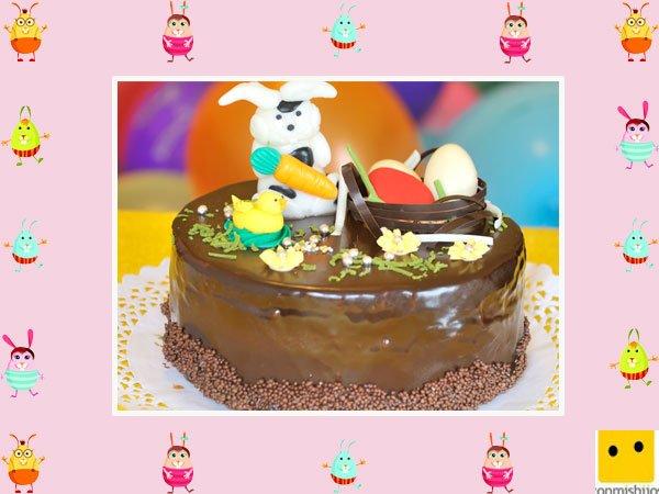 Decoración de tartas de pascua. Pastel con conejos de caramelo