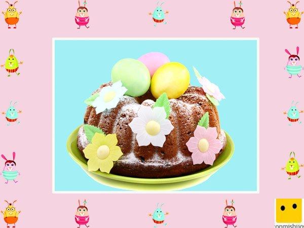 Decoración de tartas de pascua. Bizcocho con huevo y flores