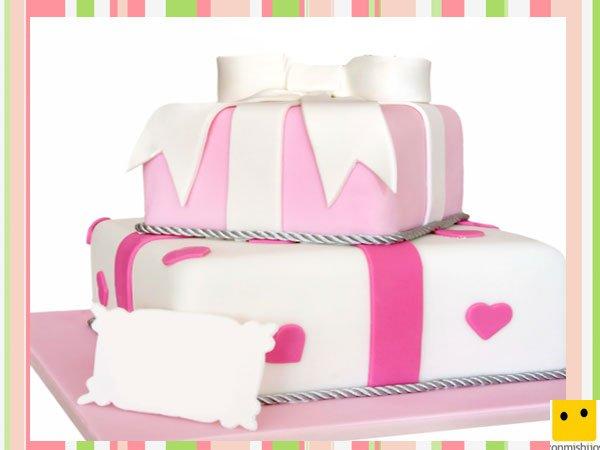 Tarta de fondant decorada como un regalo de cumpleaños