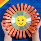 Sol decorativo. Manualidades con CDs reciclados para niños