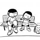 Niño aprendiendo a ponerse los patines